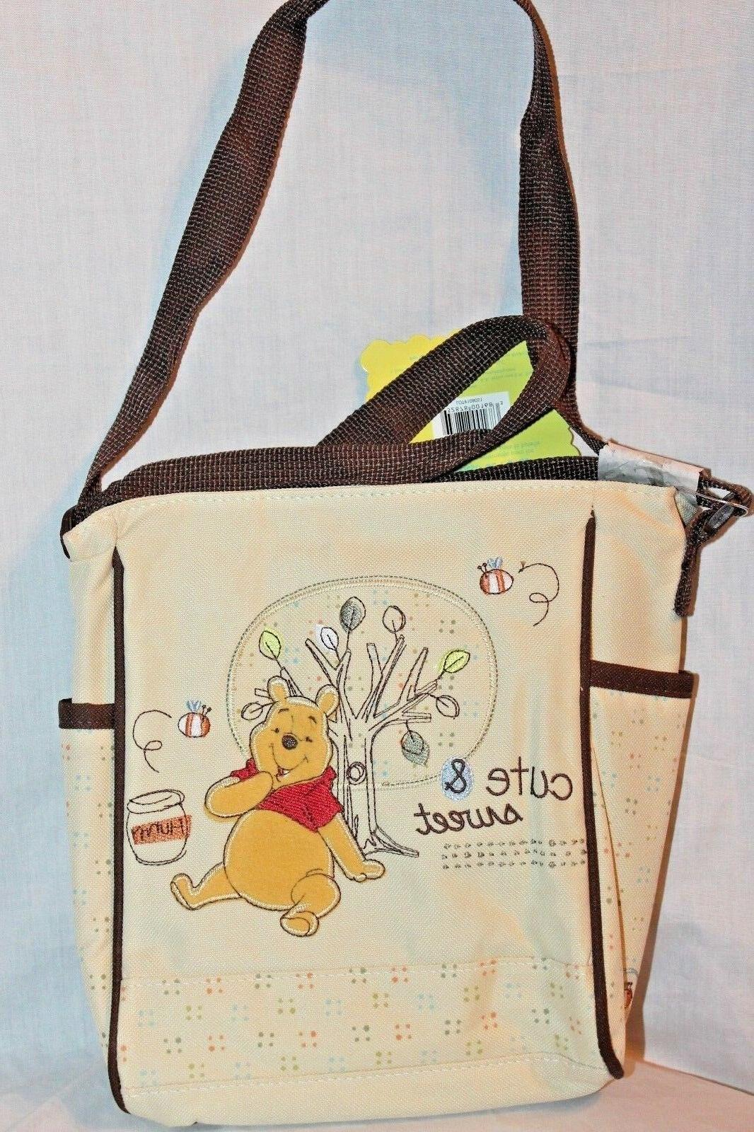 NEW WITH TAGS  WINNIE THE POOH CUTE AND SWEET MINI DIAPER BA